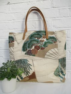 Large tote style bag made from vintage silk obi fabric in cream, brown, gold and green.
