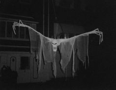 DIY Inspiration: Giant Scary Ghost on a Pulley from pumkinrothalloween. I wish pumpkinrothalloween would write a short how-to because this ghost is terrifying. From pumpkinrothalloween: The Sliding Ghost, from Halloween 1987. My brother was in the upstairs bedroom window reeling this massive thing up and then releasing it to glide down on a pulley towards kids and their parents walking on the sidewalk. Super quiet so it had many a terrified victim.  We did the pulley prop for a f...