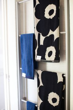 Marimekko towels in the bathroom. LOVE the Unikko (flower print) towels! Photo – John Deer | The Design Files