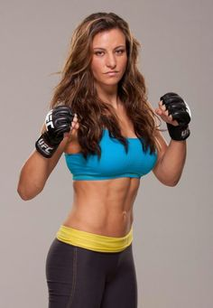 Meisha Tateis ---She is a former Strikeforce Women's Bantamweight Champion. She has also won a silver medal in the FILA Grappling Championships.