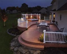 Multi-Level Timber Tech Earthwood composite deck with curved decking, curved radius Timber Tech Radiance composite rail, Outdoor Lighting Perspectives low voltage deck and landscape lighting. Located in Warren County Springboro Ohio.
