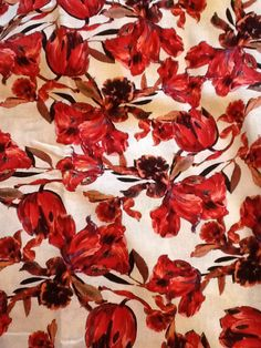 Linen type lightweight furnishing fabric (Roman Blind) - more raspberry through to reds & deep reds than this pic shows & pure white background.  Huge amount, enough for 2 dresses (original intention). But it would go well with either the Cream/ Travertine/ Raspberry painted or the Walnut/ Butterum colourways