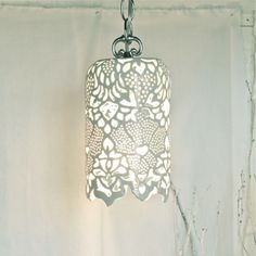 "Carved White Porcelain Pendant Lamp This hand-carved milky white porcelain pendant lamp measures approximately 11"" in length and 7"" in diameter. Perfect for an entrance way or decorative nook."