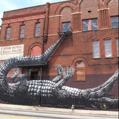 Street artist ROA in Atlanta. These people seriously blow my mind! crazy awesome