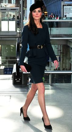 Love her! And I love this suit! Love the peplum!