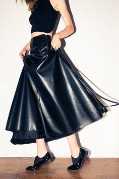 Alana Zimmer - The Coveteur.  Skirt: Maison Martin Margiela; Shirt, Theysken's Theory, Shoes, Céline