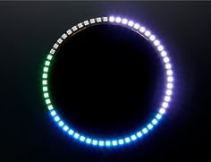 NeoPixel 60 Ring Wall Clock: This project uses the DS1307 Real Time Clock with an Arduino to display the time as a series of colored arcs. With the new NeoPixel 60 Ring, we have a perfect display for presenting the time with RGB LEDs! Hours are represented by red, minutes by green, seconds by blue. The arcs overlap and the colors mix. Minutes and seconds are each represented by a single green or blue LED, respectively. In the 12 hour version, a single red LED represent 24 minutes.