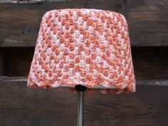 A crochet jacket for a lampshade.