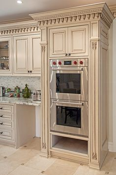 The traditional and rich art hand. Carving is the focal element in this mahagany kitchen. The painted finish in french provincial style, accentuates its details. Manufactured by WL Kitchen and Home in Lodi NJ Country Kitchen Interiors, Country Kitchen Designs, Kitchen Room Design, Kitchen Cabinet Design, Modern Kitchen Design, Home Decor Kitchen, Interior Design Kitchen, Kitchen Wood, Kitchen Oven
