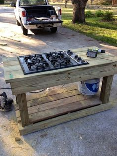 Outdoor Canning Station. Salvage range top plus easy table. Pic only, nice idea.