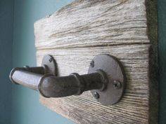 This rustic hand towel holder is handmade using salvaged barnwood, and an industrial style pipe as the handle. This piece makes a lovely addition to your home, allowing you to add style to your bathroom or any other space you choose. You can hang this piece on a wall using the installed sawtooth hanger.  *NOTE: This piece is a new (made to look old/rusted) piece that will not stain towels or chip off. Approximate Dimensions: 9 3/4 (l) x 7 (h). The pipe measures 5 1/2 across. Du...
