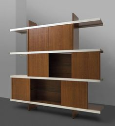 "ANGELO MANGIAROTTI Una libreria ""Multiuse"" per POLTRONOVA, 1965. Truciolare impiallacciato in teak, profili di allminio. Cm 200 (h) x 195 x 46. A ""Multiuse"" bookcase manufactured by POLTRONOVA, 1965. Teak veneered clipboard and aluminum profiles. 78.7 (h) x 76.8 x 18.1 inches."