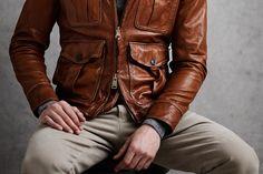 "Leather jacket with ""opposing zips""."