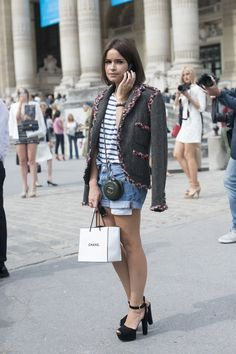 Duma dresses up a casual striped T-shirt and jean shorts with the addition of a chic tweed blazer and heels, making it ideal for a casual outfit to take you from summer to fall. Jacket and bag, Chanel; shoes, Prada
