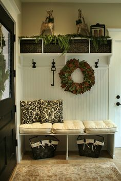 Love the bead board, shelf with baskets, bench-oh all of it!