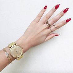 This gold Shore Projects watch brightens my red nails + gold rings.