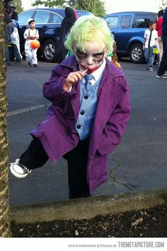 Joker kids costume o.O this is actually impressively scary...good makeup lol