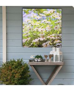 Create an organic look with nature-inspired wall art and bare wood