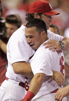 Kolten Wong gets a big hug from manager Mike Matheny after hitting a walk-off home run in the ninth inning of a game against the Pirates. Cards won 5-4. 7-08-14