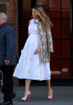 Spotted on the streets of Manhattan earlier today, Blake Lively showed that a growing baby bump needn't be an obstacle to personal style and her flattering Michael Kors empire-line white dress was sprigged with charming floral appliqués