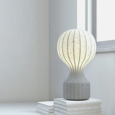 """Designed by Achille Castiglioni in 1960 for Flos, the Gatto Piccolo table lamp comprises a white powder coated internal steel structure sprayed with a unique """"cocoon"""" resin to create the diffuser, which is then protected by a transparent sprayed on finish"""