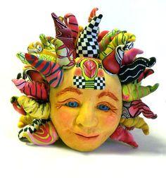 Love Alice Stroppel's colorful and imaginative sun.