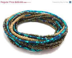 Check out this item in my Etsy shop https://www.etsy.com/listing/216190066/on-sale-seed-bead-wrap-stretch-bracelets