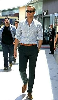 Mens street style fashion: ryan gosling business casual outfit navy green pants, brown leather belt & oxford shoes, blue white striped shirt