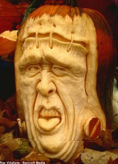 All stitched up: Frankenstein gazes out of a carved Halloween pumpkin ~ Artist: Ray Villafane 3d Pumpkin Carving, Awesome Pumpkin Carvings, Pumpkin Art, Best Pumpkin, Pumpkin Head, Food Carving, Family Halloween, Halloween Pumpkins, Happy Halloween