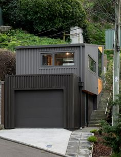 A tiny home on a bush-clad site in Lyall Bay, Wellington. Photography by: David Straight. Exterior Paint, Exterior Design, Modern Garage, Narrow House, Architect House, Open Plan Living, Large Windows, One Bedroom, Home Projects