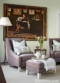 Lovely sitting area! Painting by Ryan Brown. Chair and ottoman fabric is Plymouth Grey by Mitchell Gold + Bob Williams.