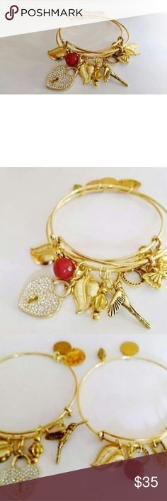 Gold Adjustable Charm Bangles There are 2 gold adjustable bangles full of charms.  At bottom hand stamped love hope heart etc. Top one deep crimson red faceted bead high with gold and gold plated charms heart bird crystal origami heart can take off n wear as necklace or leave on bangle leaf and more. earth and sea jewelry Jewelry Bracelets