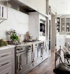 Kitchens I Have Loved with a Le Cornue stove to die for in graphite/gray/silver