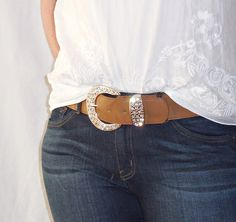 Add a bit of flair and sparkle to your outfit with this lovely crystal studded buckle belt! It is stretch so you can either wear it with your pants or with a dress! Jazz up any outfit with the sparkle from this fabulous belt! If you enjoy sparkle as much as I do, you're sure to love it!