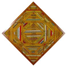 """Cigar Silk Quilt   A """"cigar band"""" quilt made from cigar bands - back in the 1800's, each bundle of cigars was wrapped and tied with satin ribbons. The quilter took these ribbons and pieced them together to make the quilt."""