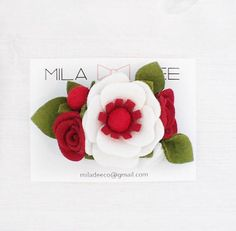 """Red and white daisy felt flower cluster on a alligator hair clip Approx. size 3""""L x 2""""W Mila Dee Co. headbands and Hair clips are the perfect accessory to your little babes wardrobe! Our headbands are made of a soft and stretchy nylon that will grow with your babys head. Our hair clips"""