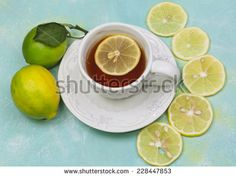 tea with lemon lime citrus vitamin C - stock photo