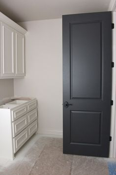 Door color is wrought iron by benjamin moore trim paint color: westhighland white by sherwin williams