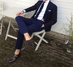 navy blue suit...notice the suspender...