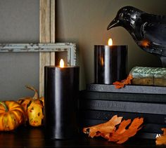 flameless flicker pillar candles in black, $60-70 (each?! ouch!) | Pottery Barn 2014 catalog