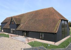 million guide price (picture 1 of With a gym, steam room, hot tub and home cinema - this is the ultimate luxury barn conversion. Barn Conversion Exterior, Barn Conversions, Roof Design, House Design, Home Theater Speaker System, Old School House, Wooden Barn, Converted Barn, Barn Renovation
