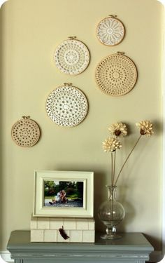 Vintage knit lace doilies inside Embroidery Hoops and hung on wall