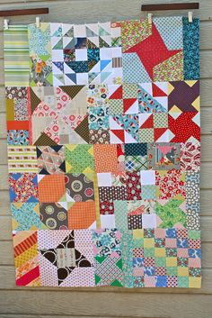 Orphan Block Quilt (fantastic idea for those leftovers!)  Love this scrappy baby quilt by My Go-Go Life