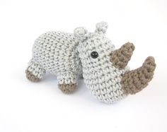 Small amigurumi rhino - Crocheted soft toy - Baby toy - Stuffed animal - Small rhinoceros - Cotton - Light grey. €23.00, via Etsy.
