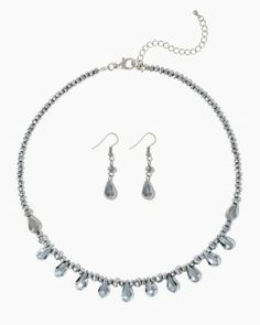 Shop necklace and earrings sets. Black or silver. A row of teardrops hang from shimmery rondelle spacer beads. Matching danglies.