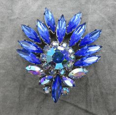 Show off your fashion sense with this lovely Juliana cobalt blue AB crystal jeweled brooch.