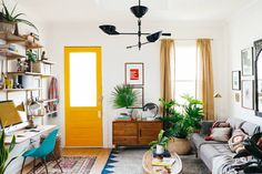 Color in a room with white walls, wood accents, & plants