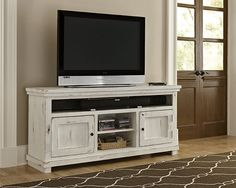 Fall in love with the Willow TV Stand: Distressed White by Progressive Furniture at Orange Park Furniture, where everything 'feels like home', proudly serving Orange Park, FL and all of Northeast Florida for over 40 years! White Tv Stands, Cool Tv Stands, Diy Tv Stand, Nebraska Furniture Mart, Diy Entertainment Center, Wood Bridge, Tv Cabinets, Ikea Hacks, House Design