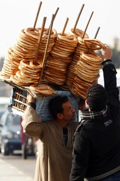 Egypt - Streetvendor- In Egypt they eat pretzels with Dokka (toasted sesame- cumin- ground coriander) and a hard boiled egg - optional white Feta or Romano cheese.Imagine eating this with your loved ones by the banks of the Nile or by the sea. http://exploretraveler.com