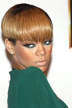 his is a stylish look as Rihanna has her hair short and straight. The hair is styled really short around at the ears and back but with a straight, choppy fringe that covers the forehead.    This is a short haircut.